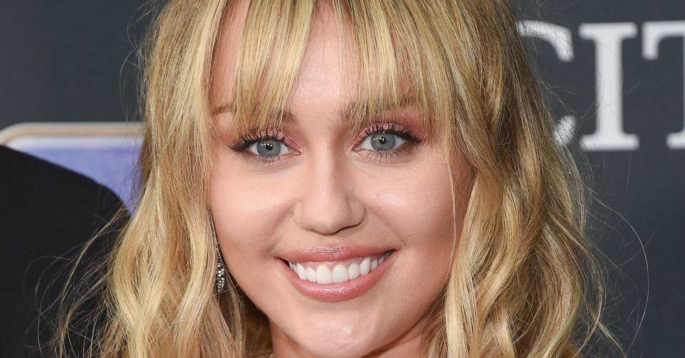 Miley Cyrus Rocks Rainbow Bikini For PRIDE Pool Splash