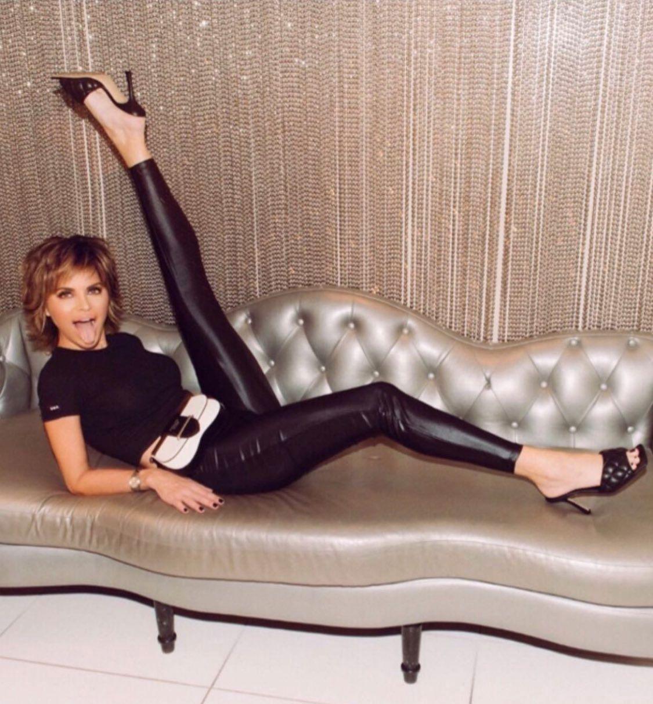 Lisa Rinna kicking leg on couch