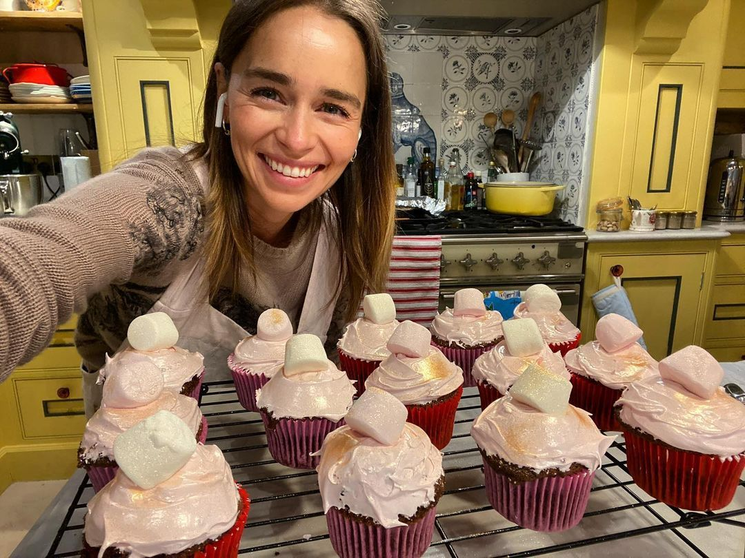 Emilia Clarke home with cupcakes