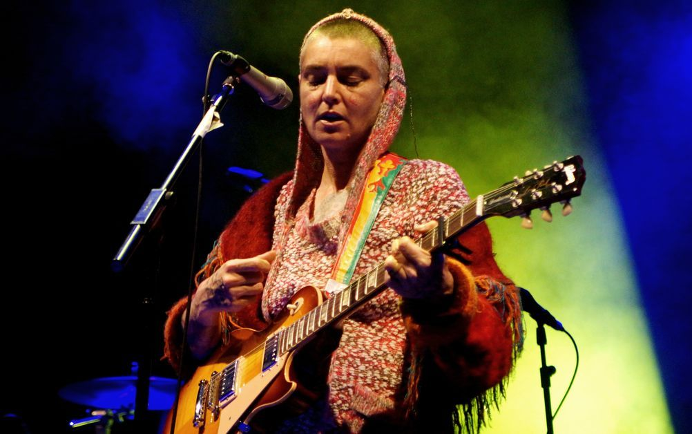 Sinead O'Connor performs at an event.