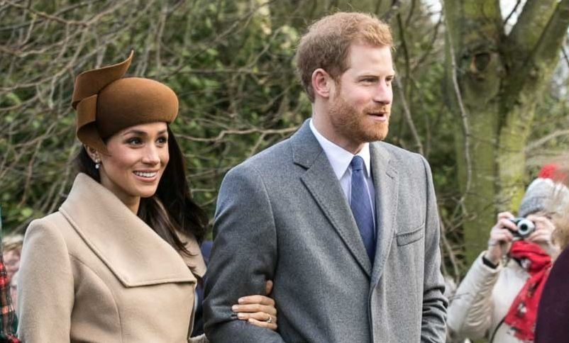 Meghan Markle holding on to Prince Harry's arm