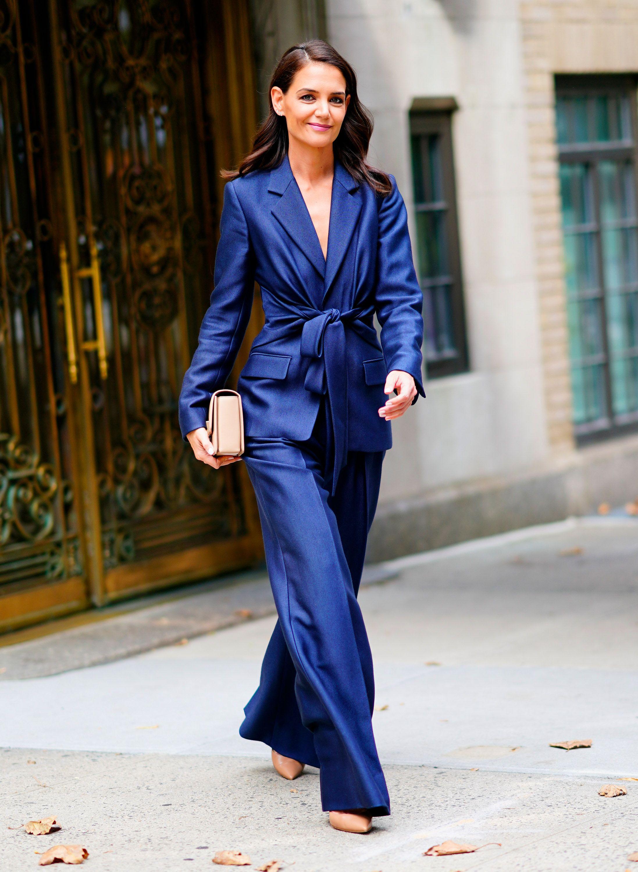 Katie Holmes walks the streets of New York City wearing a runway-ready cobalt pantsuit.