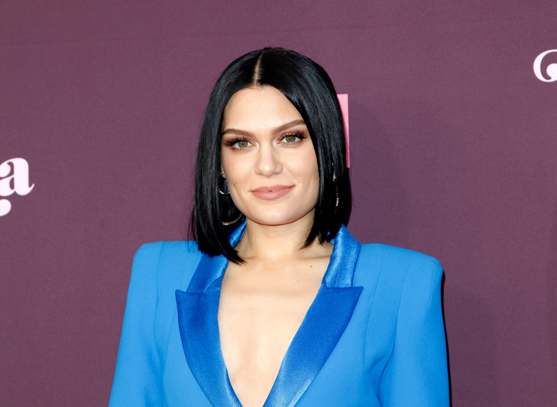 Jessie J in a blue blazar with her black hair short.