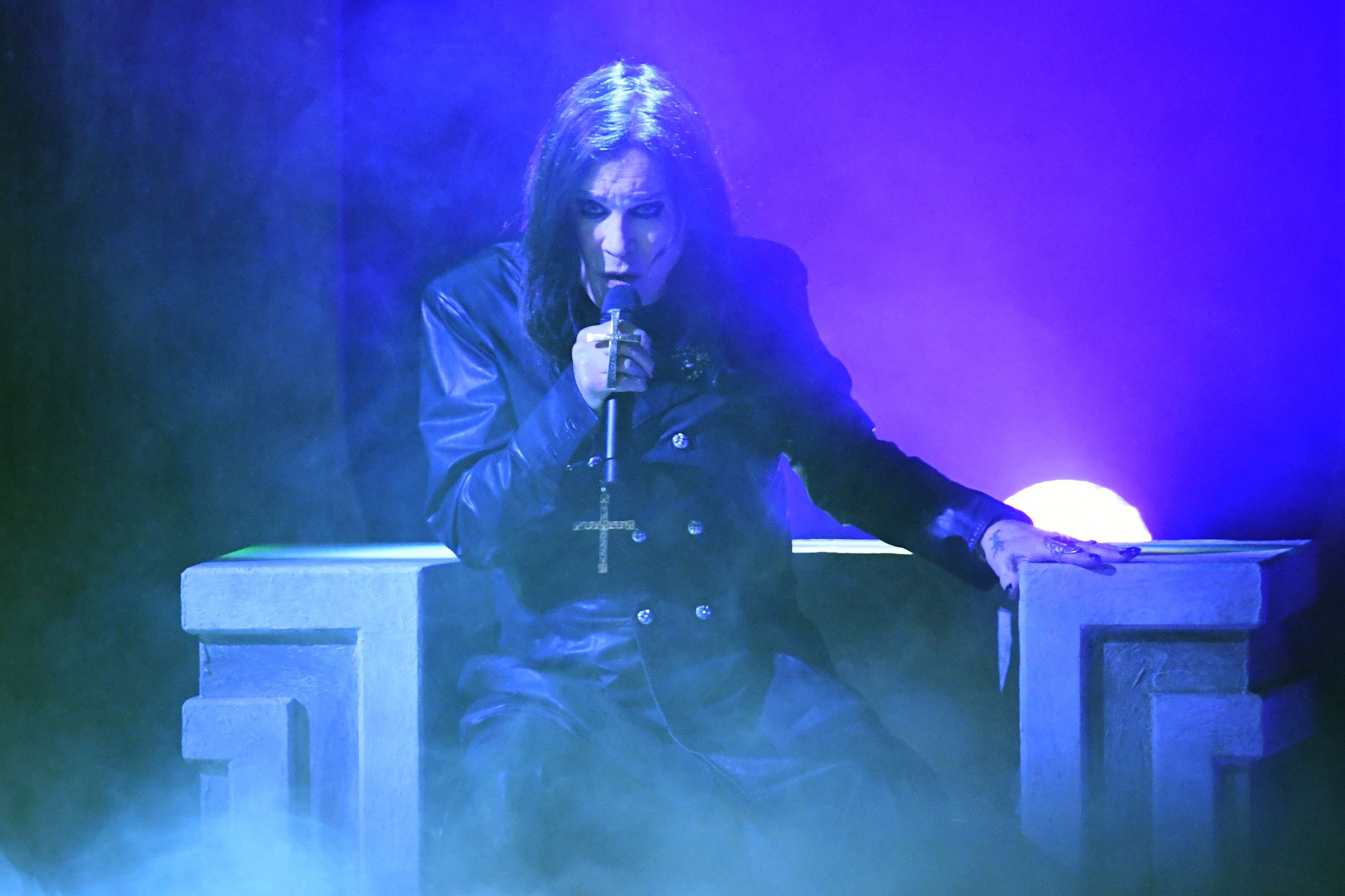 Ozzy Osbourne performing on stage.