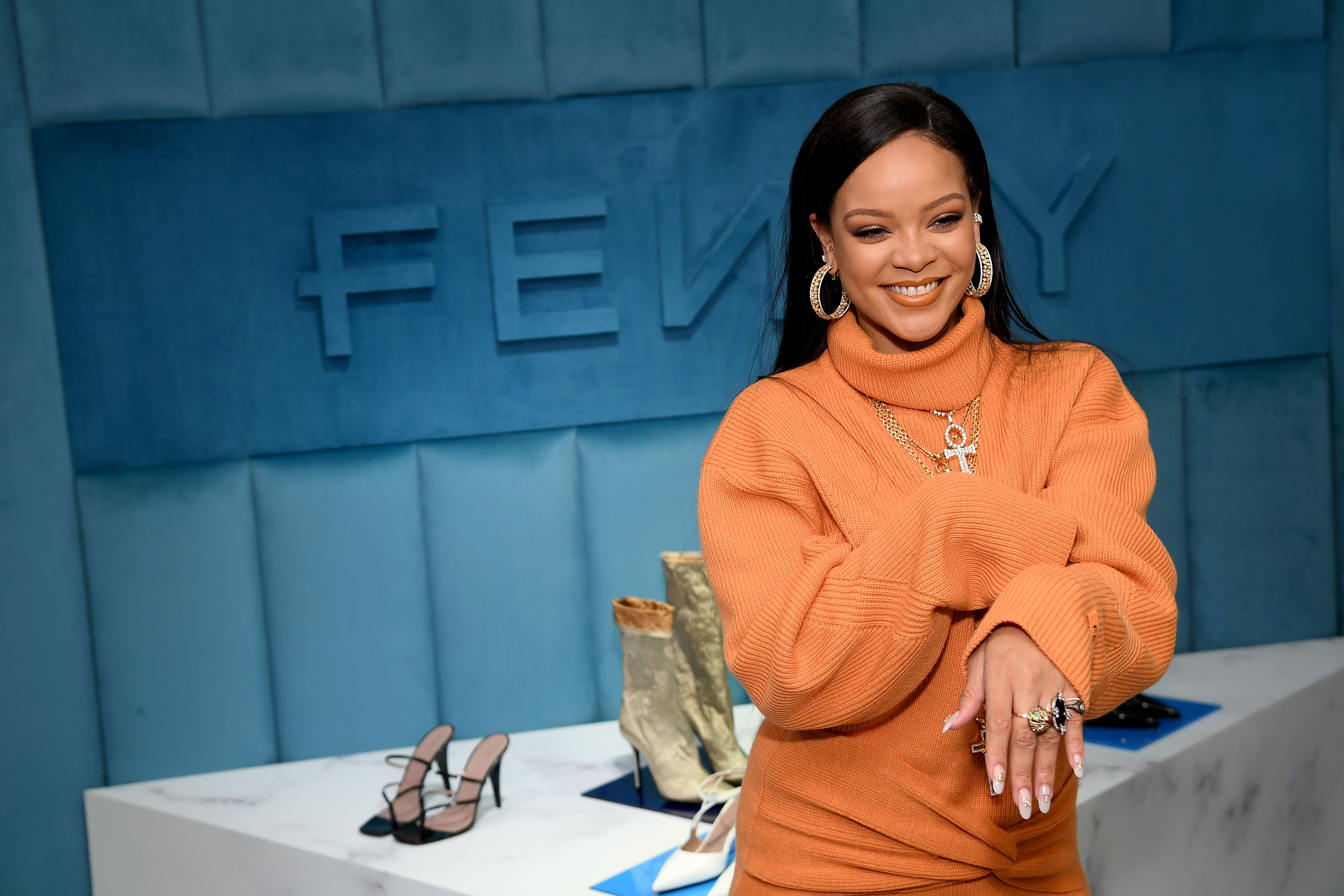Rihanna promoting her Fenty makeup line.