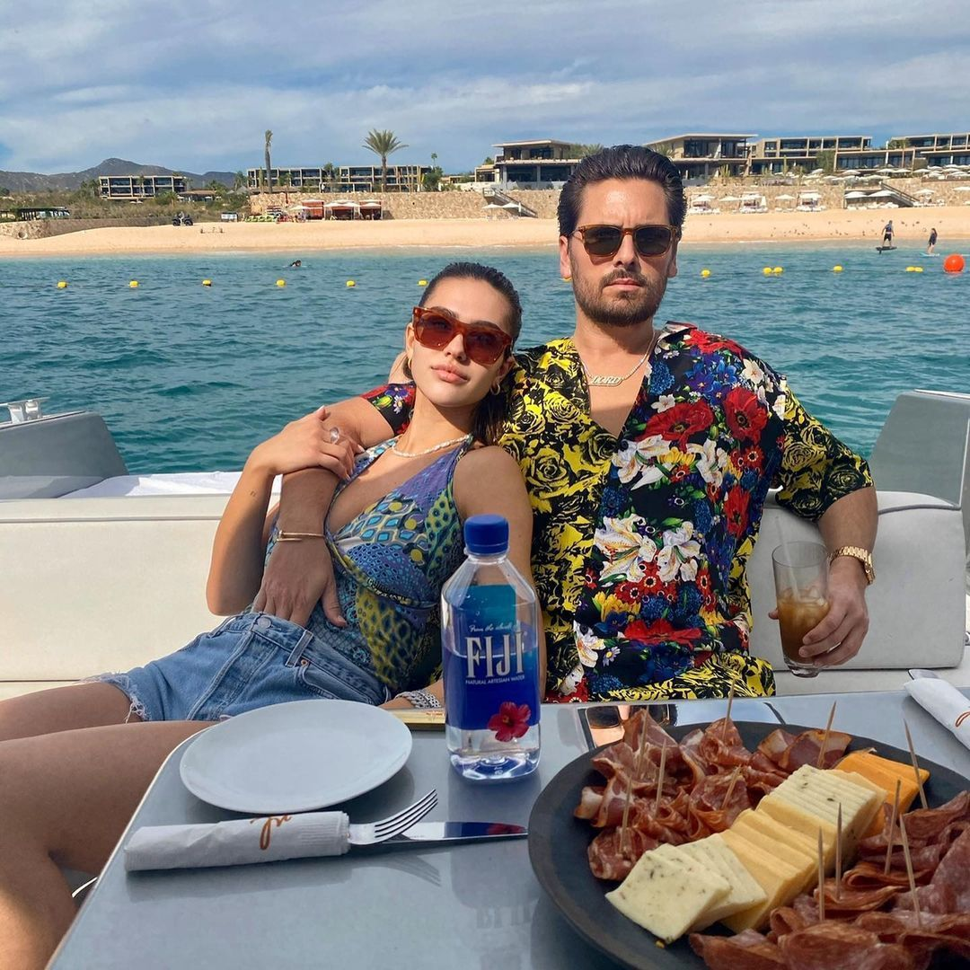 Amelia Hamlin and Scott Disick by the water