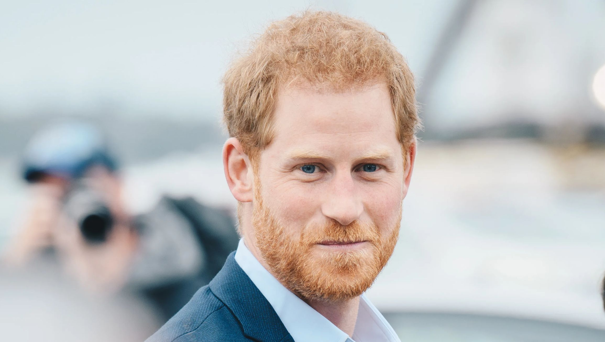 Prince Harry smiling at the camera.
