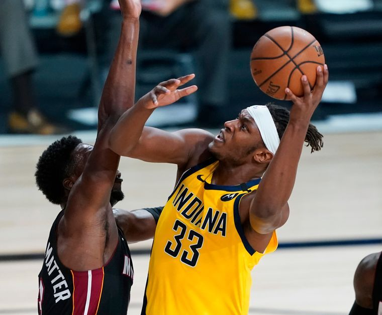 Myles Turner scoring the ball against Bam Adebayo
