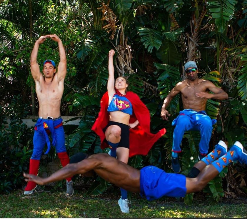 The Quarantine Crew poses while wearing Superman themed outfits
