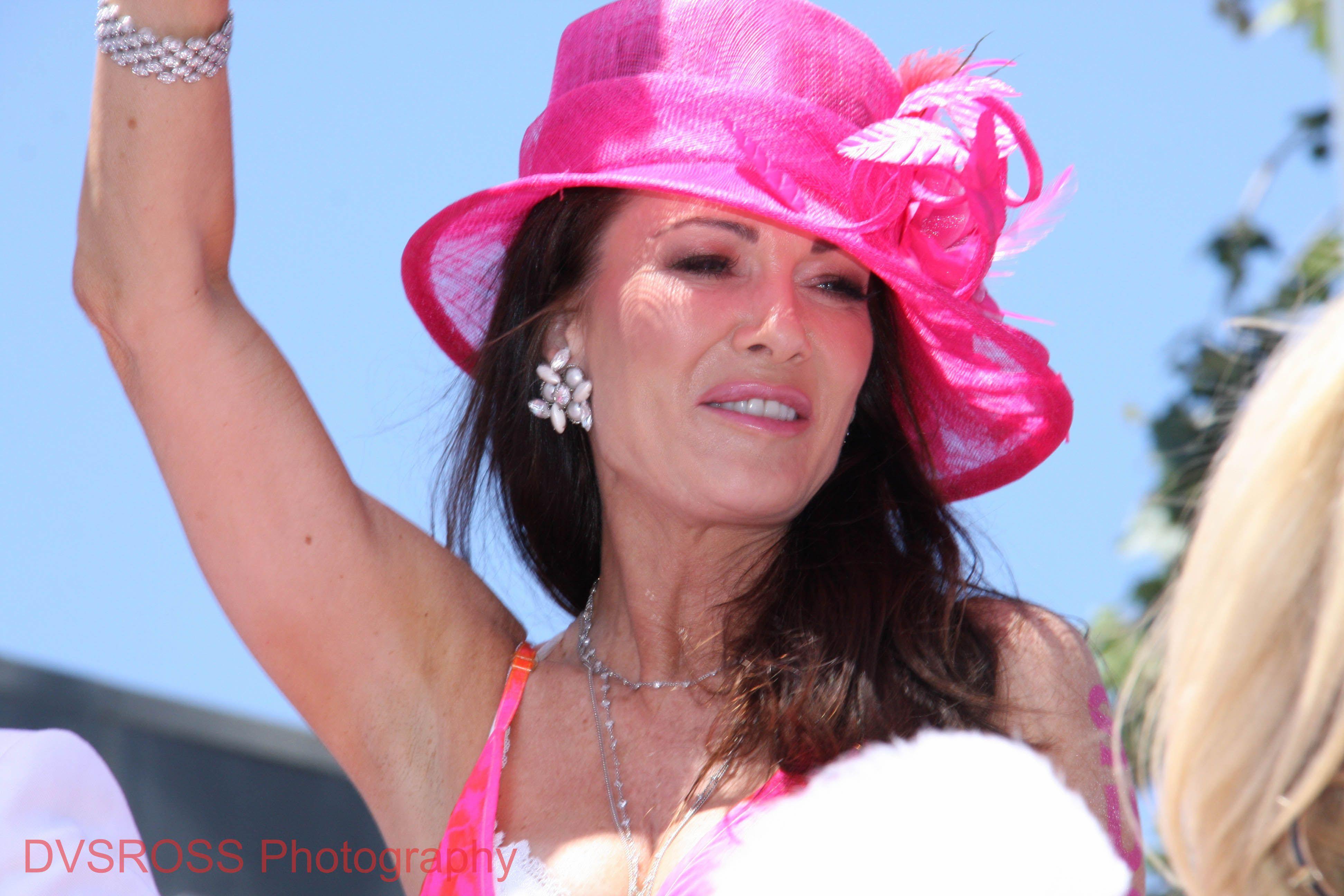 Lisa Vanderpump, dressed in her favorite color pink, waves to fans.