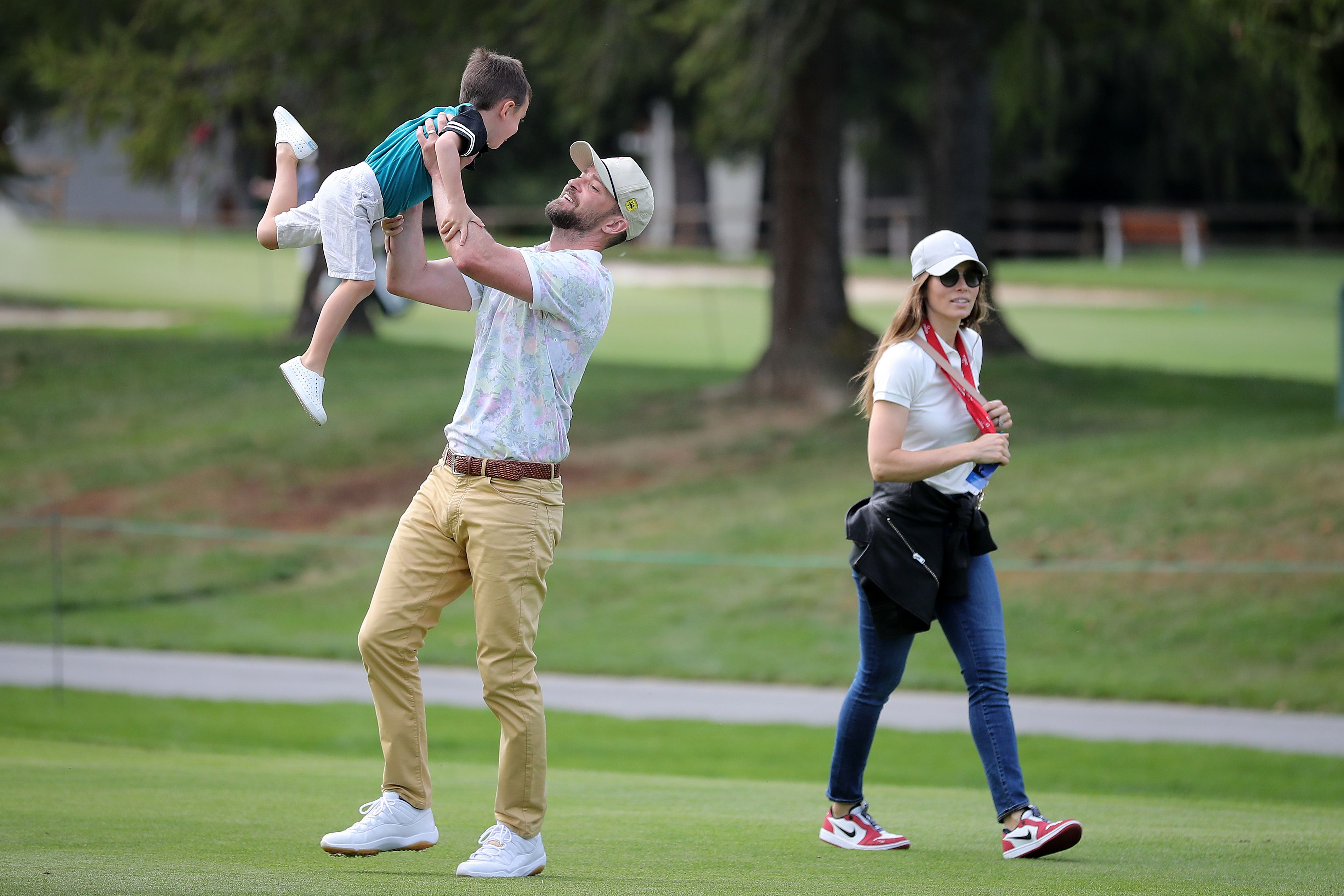 Justin Timberlake, Jessica Biel, and their son playing outside