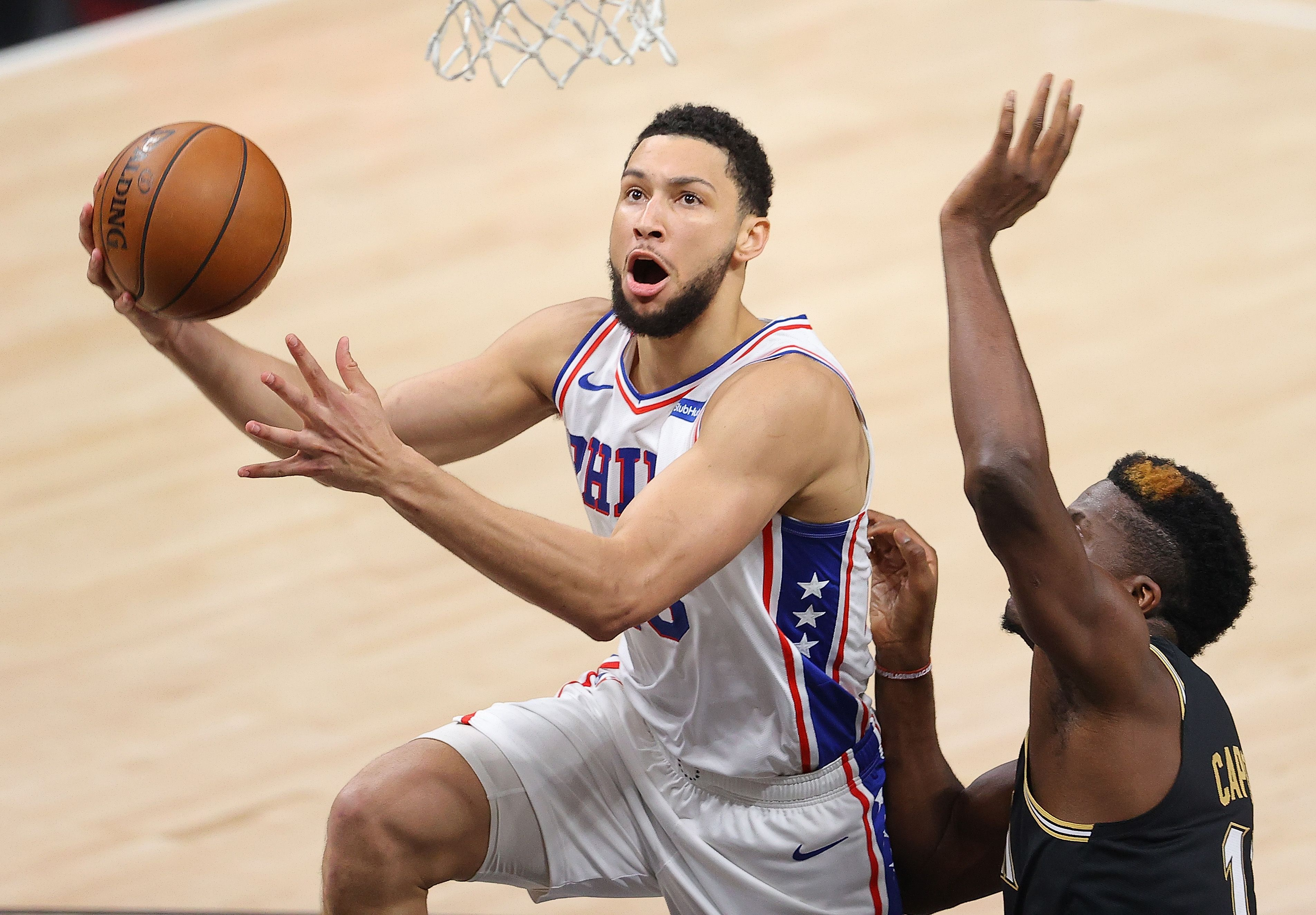 Ben Simmons trying to score against Clint Capela