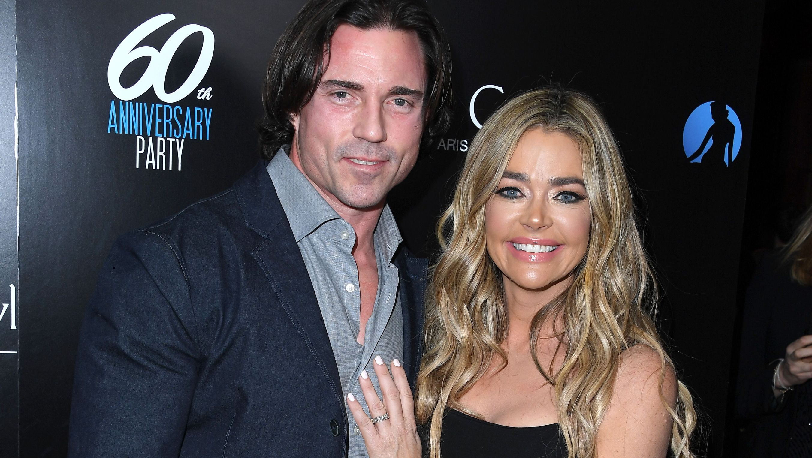 Aaron Phypers and Denise Richards attend an anniversary party.