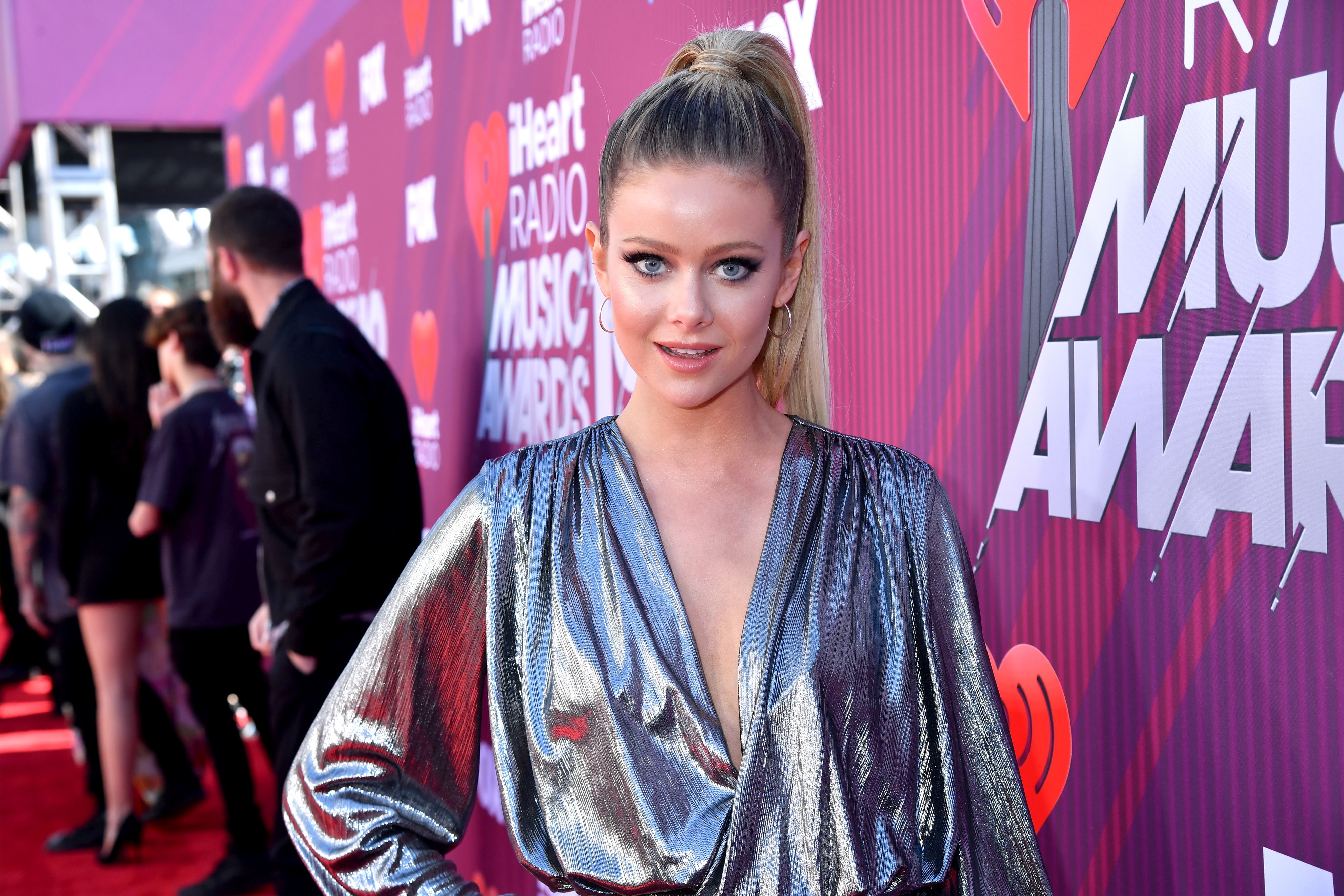 Hannah Godwin on the red carpet of an event looking spectacular in a sliver dress.