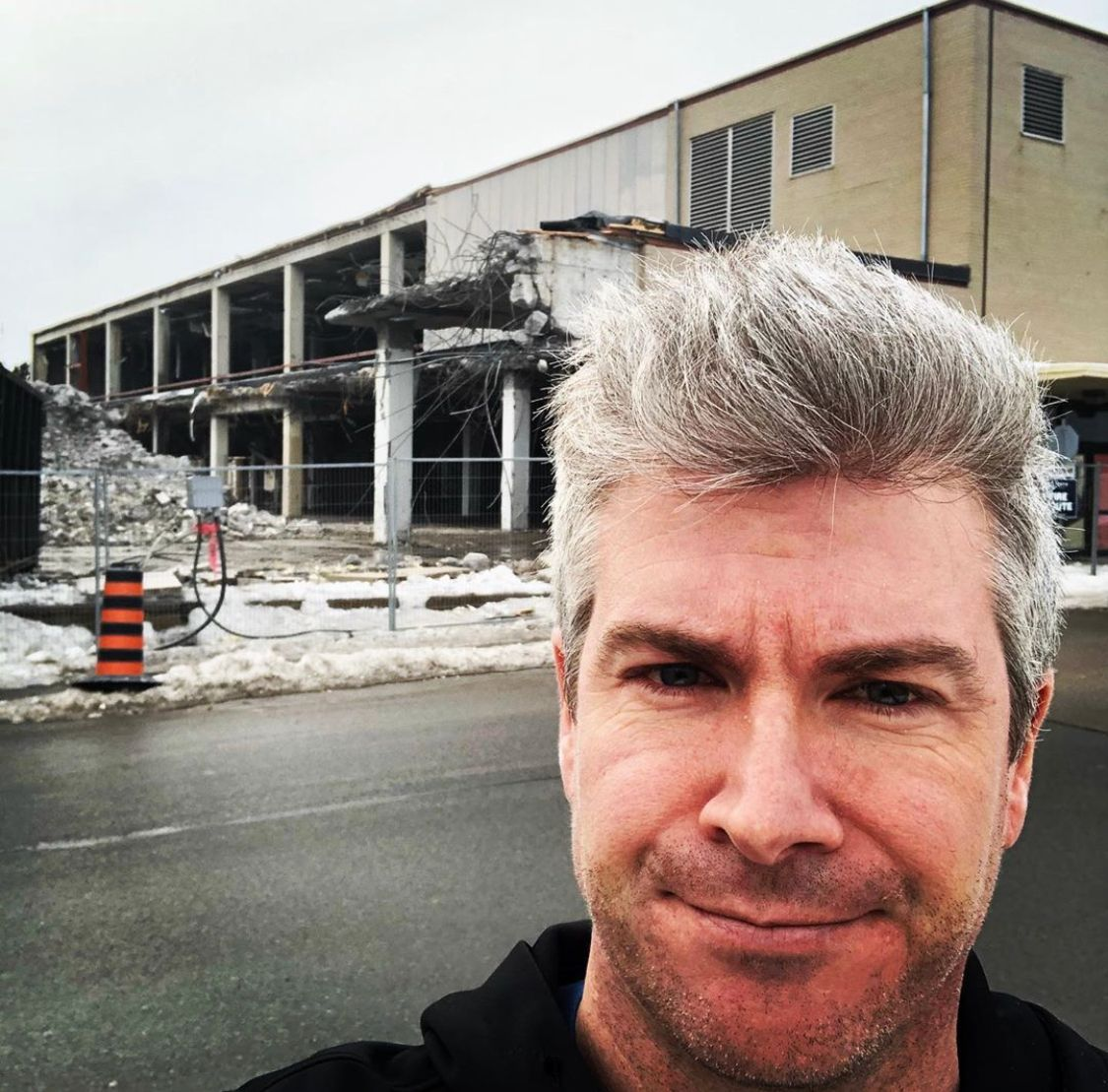 A selfie showing Dan O'Toole opposite a construction site and he looks dashing up-close.