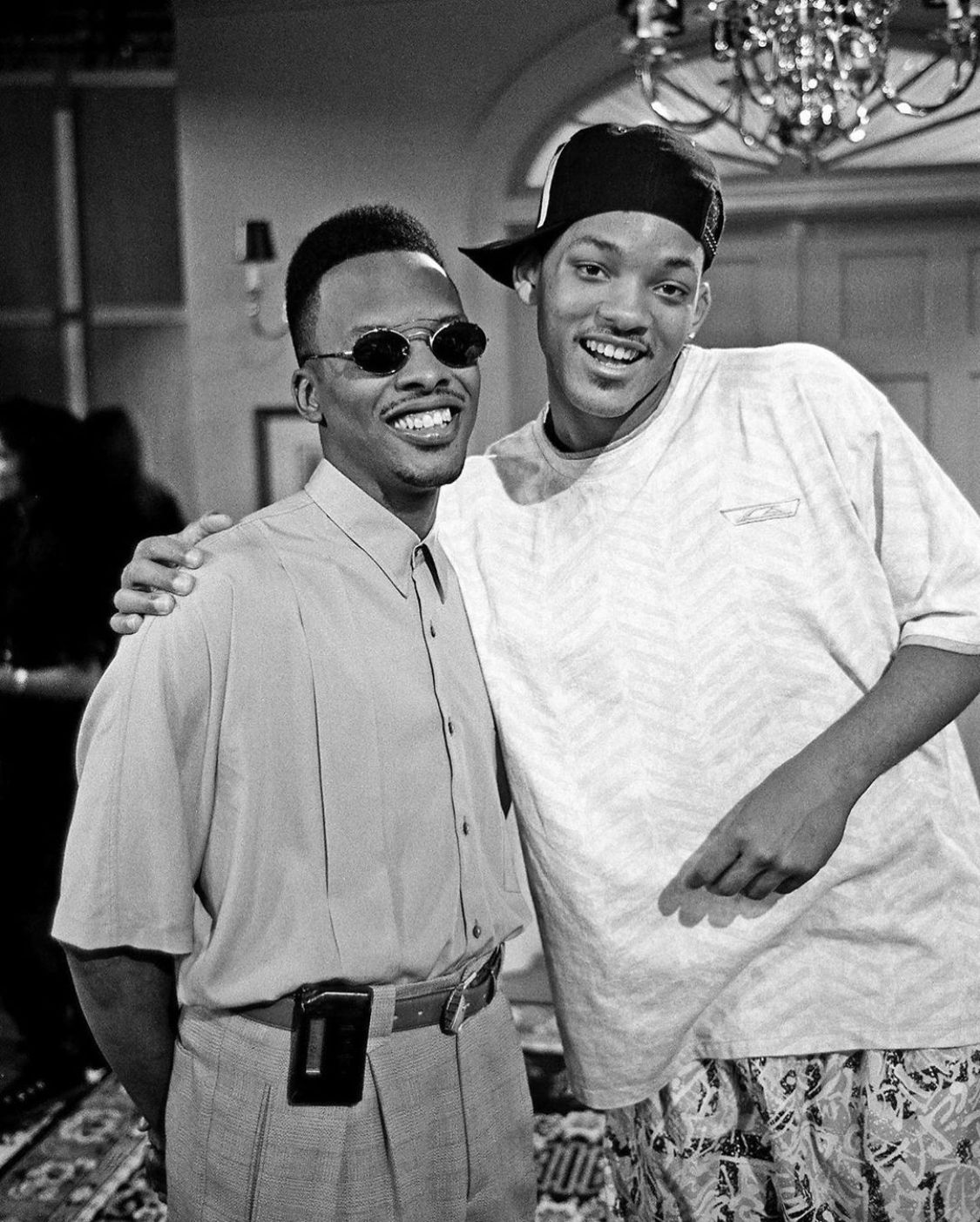 A lovely photo showing young Will Smith and a colleague while on set and they look amazing.