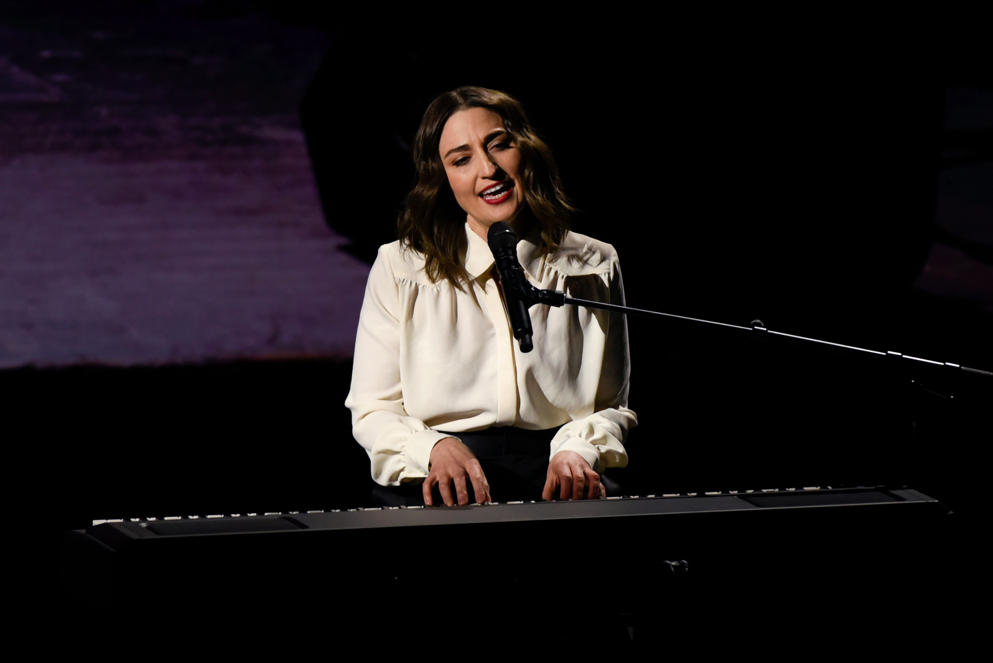 Sara Bareilles performing on stage