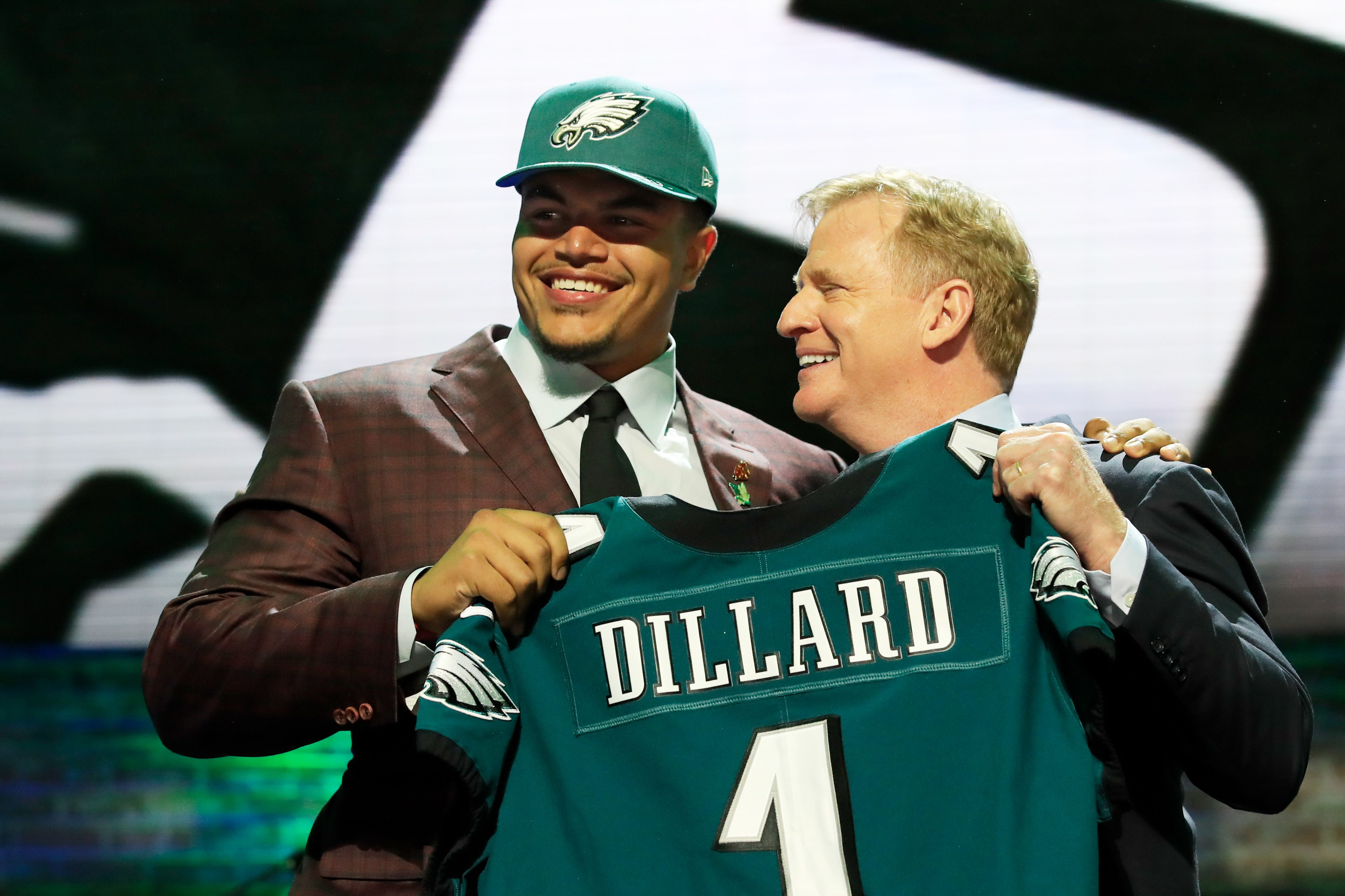 Andre Dillard holding his Eagles jersey