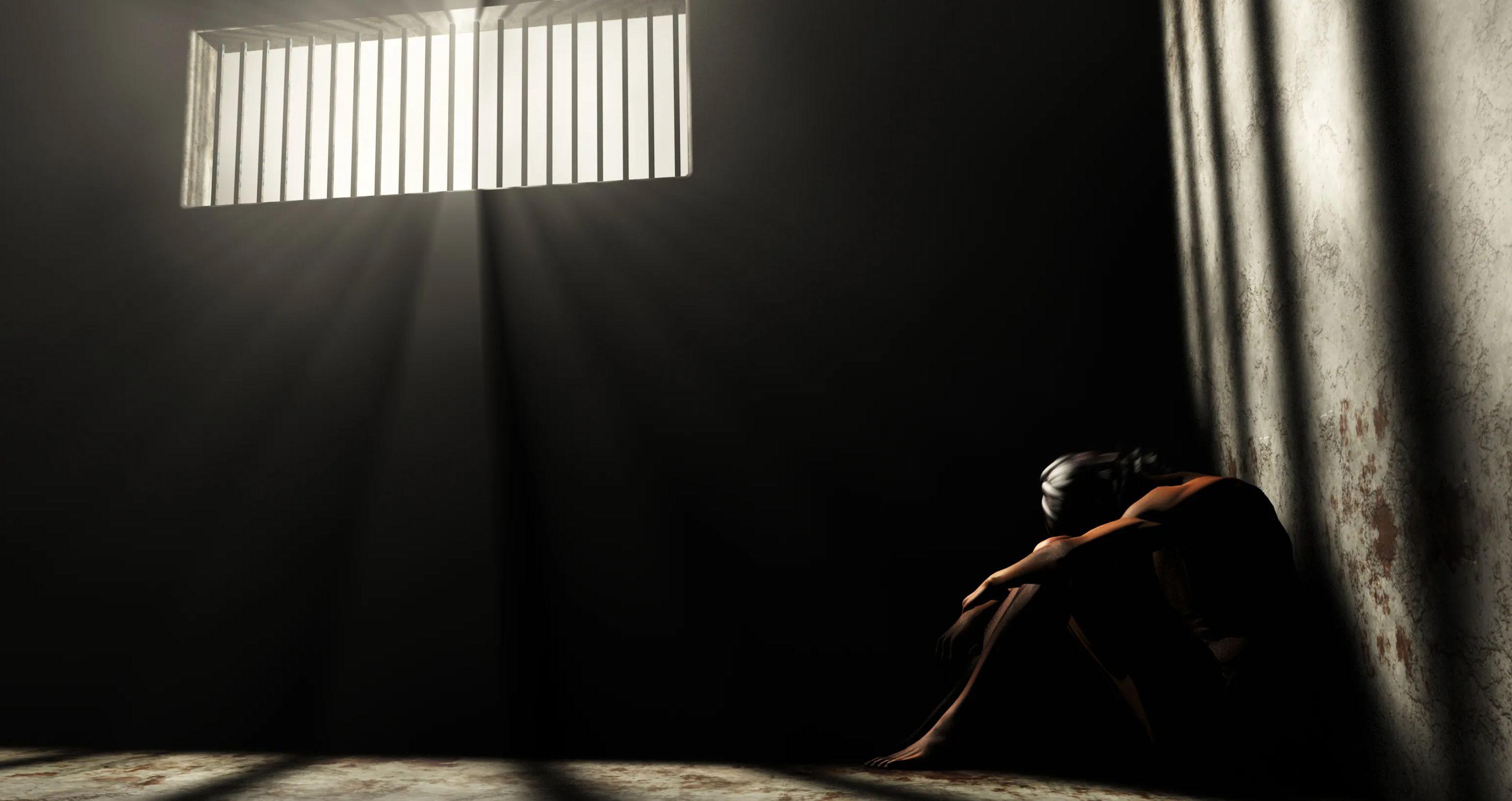 Photo illustration shows prisoner in solitary confinement.