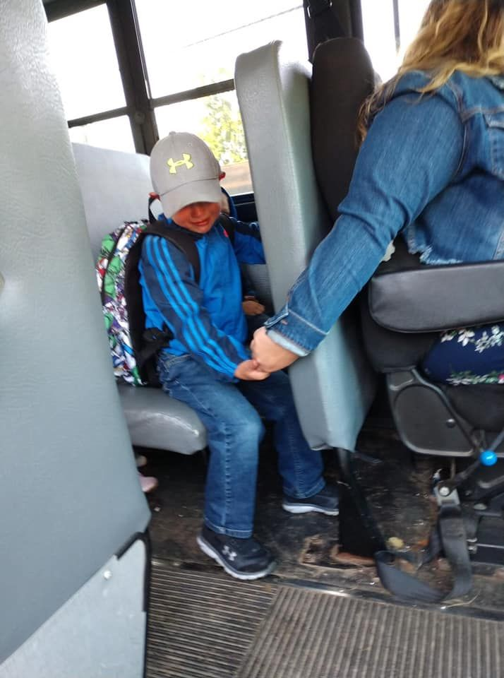 Touching Photo Of Bus Driver Holding Boys Hand On First