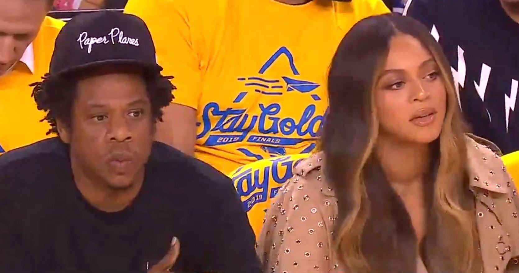Beyonce appears unamused as woman leans over her to talk
