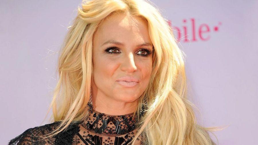 Britney Spears in short white dress in Beverly Hills